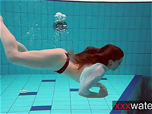 Pierced teenager swimming