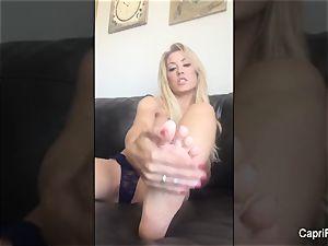 Capri massages splooge into her sumptuous soles