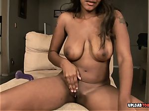 chesty dark-hued sweetheart frolicking with her puss