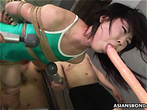 asian trussed up to be sexually tormented by some cranks