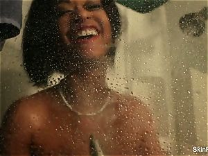 pornographic star skin Diamond plays with plaything in the shower