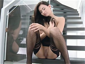Stairway onanism from dark-haired stunner Michaela Isizzu