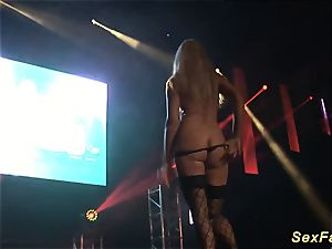 buxom mummy unclothing on public stage