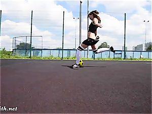 Jeny Smith toying some football