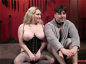 big-boobed blond domina Gives Her sub a hand-job